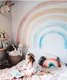 #wallmural envy right here! So fun yet so sophisticated in a way....maybe it's the fluid feel the #watercolor mural exudes. Such a unique way to spice up #whitewalls I love the #rainbowpillow too!!!