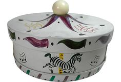 Vintage biscuit tin in whimsical carousel design. Tented lid design with ball finial top. Made by Guildcraft, NY as marked on bottom.