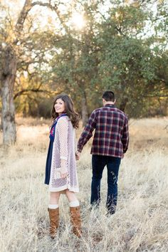 Engagement Portrait Holding Hands Walking Through Field Girl Looking Back at Camera | Chico-California-Engagement-Wedding-Photographer-Bidwell-Park-Engagement-Photography