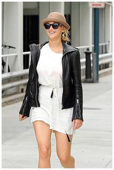 Jennifer Lawrence - Santa Monica, CA - Jennifer wore a cute bowler hat to go with a romper dress and leather jacket to stay warm during the movie.