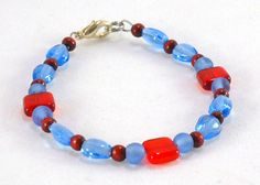 Red and blue beaded bracelet by TheBeadedCatsEye