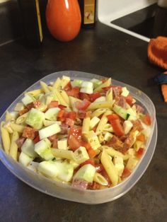 Antipasto salad I made for work potluck! Tastes amazing! Noodles, salami, pepperoni, pepper jack cheese, tomatoes, red bell pepper, cucumbers, and vinegar olive oil dressing!!!!