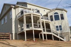 Enlarged double deck and covered porch with Trex composite deck materials. Trex Decking, Composite Decking, Double Deck, New Deck, Atlanta Georgia, Porch, Multi Story Building, Mansions, House Styles