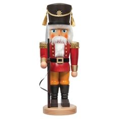 Guard dressed in red and standing post, traditional stained German Nutcracker.