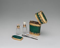 The end of the XVIII century. Pocket set: mirror, tweezers, spoon ear cleaning, nail file and two bottles of perfume.