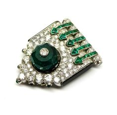 Art Deco diamond and emerald clip brooch by Cartier, c.1925