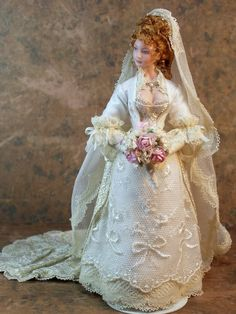 This combines two of my favorite things: wedding dresses and barbie dolls, which, for a guy, is a quite demoralizing admission.