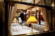 The Orient Express Restaurant  at Taj Palace Hotel in New Delhi pays homage to the opulent train travel its namesake afforded passengers. The dining room is modeled after the dining car on the legendary train, and the bar replicates a railway station platform. The food is European, offering a four-course menu inspired by the cuisines of the countries the train passes through.