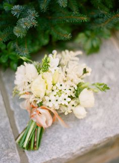 Various white flowers in this white wedding bouquet.  Photo by Ali Harper.
