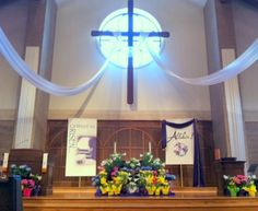 Easter Sanctuary at Wildwood Presbyterian Church, 2012.  Tulips, Daffodils and Hyacinths were used along with the Lilies.  Draped fabric to the cross, gave a dramatic effect.