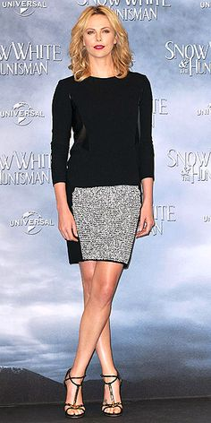 Loving Charlize's red lips and patterned skirt!   http://www.peoplestylewatch.com/people/stylewatch/gallery/0,,20595372,00.html