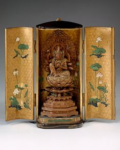 Portable Shrine with an Image of the Horse-Headed (Batô) Kannon  Period: Edo period (1615–1868) Date: ca. 1620 Culture: Japan Medium: Fruitwood image in lacquered case with gold-sprinkled designs