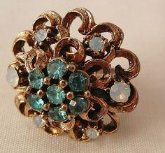 Very pretty Aqua color and opal look rhinestone slight dome Ring