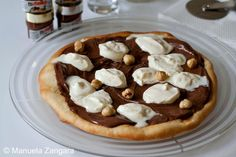 Nutella Desserts - Nutella Pizza. Did the Nutella thieves tempt your appetite? Because they definitely made me drool over a Nutella bite. So in order to give you and myself some choices, I selected some desserts that you can make using Nutella, like brownies, truffles, smoothies, cakes, macarons, fondant and much much more. You can find all the desserts and recipes at our website.