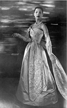 1956 Renée Breton in ivory satin ball gown with embroidered panel attatched to the bodice that can be worn as a stole, by Christian Dior, photo by Georges Saad