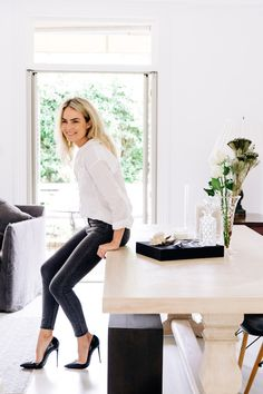very casual but I like the pose leaning on the desk. we can lean you on the back of the white leather couch