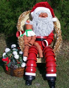 #Pottery #Santa watches over the front yard during the #christmas season.  Adorable.