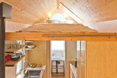 http://downsized.co/living-off-grid-140-square-feet/
