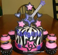 Rockstar themed cake with matching cupcakes made for a girl's 6th birthday!  www.cakehappynw.com