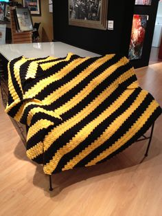 The University of Iowa Hawkeyes afghan. Made in the Corner to corner pattern. This is where I got the pattern: http://thecrochetcrowdblog.com/2013/06/08/crochet-corner-to-corner-afghan-project-youtube/
