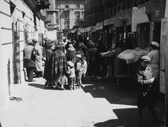 People shopping at the market off Dzielna Street in the Jewish ghetto.  Location:Warsaw, Poland  Date taken:1938  Photographer:John Phillips