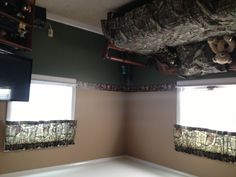 For Michael's spare basement room he gets to decorate- green halfway up, tan on top.