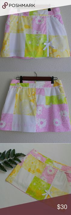 """Charming Lilly Pulitzer Skirt Adorable Lilly Pulitzer floral mini skirt.  Front slant pockets, back zipper enclosure and lined with shorts. Perfect for summer!  Waist 15"""" lying flat Legnth 14"""" Lilly Pulitzer Skirts"""