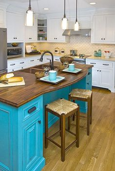 White Kitchen with a Turquoise & Butcher Block Island