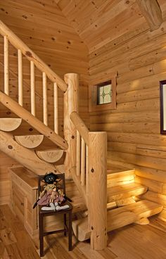 L-shaped half-log stairs lead to the upper-level loft and a quiet master bedroom. Cabin Loft, Log Cabin Homes, Log Cabins, Barn Homes, Mountain Cabins, Rustic Homes, Rustic Cabins, Western Homes, Stair Railing