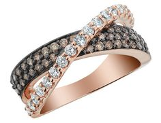 White and Champagne Diamond Infinity Ring 1.0 Carat (ctw) in 14K Rose Gold.. I dunno if it is me or what, I just do not care for those so called chocolate diamonds, or as they call them here champagne? 1700 bucks. If my man brought this home to me, I'd make him bring it right back.  YUK.. It is pretty, yet I would rather have all white diamonds or colored gem stones, not those brown diamonds.  Where were these colored diamonds 10 years ago?  They must be severely flawed diamonds,
