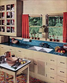 A lovely cream, blue and red kitchen from red featuring a linoleum counter. #vintage #1930s #interiors