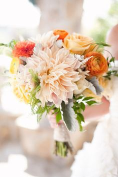Shades of peach with pops of orange   button and dinner plate dahlias and ranunculus    bridal bouquet by honey and poppies, via Flickr