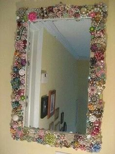 Mother & daughter project.. go to garage sales,second hand stores,and goodwills.. look for costume jewelry and awesome pins and nick nack type stuff.. glue to frame of a cheap mirror for a awesome mirror