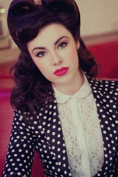 Victory rolls and that pink lipstick!