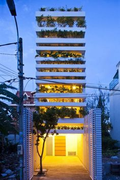 Saigon, Vietnam - The Stacking Green House  The house offers beautiful plant life at almost every perspective. The green façade and roof top garden protect its inhabitants from direct sunlight, street noise and pollution, while also saving lots of energy through natural ventilation.