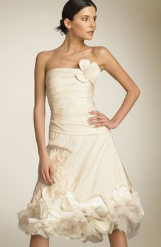 <div> <p><strong>Description:</strong> <span>Raw-edged fabric and tulle flowers embellish a divine dress, boned  for a shapely fit. Netting gives the skirt volume. </span>Exquisite short dress for  beach wedding, summer wedding and any other informal wedding. Available  color:    white, ivory.</p> <p><strong>Fabric:</strong> Taffeta/Satin<br /> <strong>Embellishment:</strong> Sash<br /> <strong>Silhouette:</strong> Empire<br /> <strong>Sleeves:</strong> Sleeveless<br /> ...