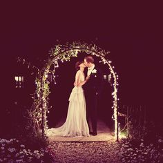 "Brides.com: Real Wedding Moments. ""After dinner Howard and I slipped away for a bit—we'd been busy mingling with guests, and wanted a moment alone together to admire the evening's gorgeous full moon. My mother had decorated the garden arbor with twinkle lights, which created an ethereal corona of light around us. (My parents still haven't taken them down because they remind them of our wedding day!) This photo encapsulates how I've felt about Howard since the day I met him seven years ..."