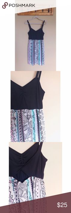 PacSun | Printed Sundress Cotton solid black top with a open triangle back that emphasizes the dresses flowy bottom with beautiful pastel detail. This dress is so comfortable and easy to wear. Perfect for summer and springtime. Excellent condition - only worn once or twice. Sounds & Matter  Dresses