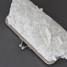 A Glossary | The A-Z of Bridal Accessories - Guipure lace (pronounced gip-pure): A heavy lace with open background, featuring lace motifs that are held together by large connecting stitches. Sometimes known as Venise lace in the United States.