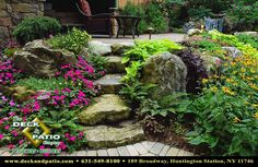 Raised patio, waterfall and spa area. This area was raised up and the grade was held back with large moss rock boulders and lush plantings. This is a great place for a nap.