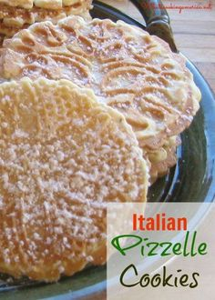 Pizzelles 1 1/2 cups all-purpose flour 1 teaspoon baking powder 3 eggs, beaten 3/4 cup granulated sugar 3/4 cup butter, melted 2 teaspoons pure vanilla extract 1 teaspoon anise seeds Powdered (confectioners) sugar