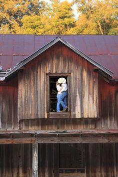 Kissing in barn loft engagement photo