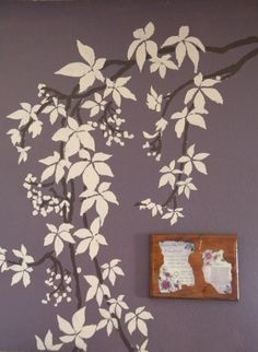 This is the white tree with brown branches against our purple living room walls.