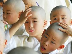 Newly-shaved Japanese boys wait for a ceremony to enter the Buddhist priesthood, in  Higashi Honganji temple in Kyoto, central Japan.