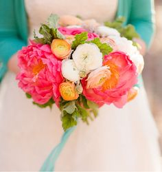 The gorgeous bouquet by Janie Medley Flora Design contains: coral peonies, peach and white ranunculus, dusty miller and scented geranium leaves that she wrapped with midori ribbon.