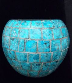 This old turquoise Native American vase would be placed on the top of the chest and filled with  a silk sunflower arrangement.