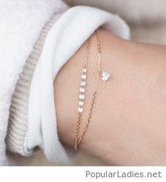 Lovely gold bracelets with a little heart