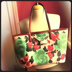 Marc by Marc JacobsJerrie Rose Metropolitote MBMJ Jerrie RoseMetropolitote in Desert Rose!  Gorgeous pattern PVC with genuine cowhide leather trim, cotton lined.  Green and pink floral print is complimented nicely with stripes on the back of this bag. Features include mini front pocket, key chain latch, and small green zippered pouch inside! Carried once for less than an hour by my mother, who decided she has too many bags! This bag is pristine with care card included. Not sure I want to…