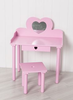 This gorgeous children's dressing table is painted a vibrant shade of pink and features pretty heart cut outs on the drawer and stool as well as a heart shaped safety mirror. The cute children's furniture set is great for encouraging role play whilst the handy drawer is an ideal place to keep all your hair accessories and trinkets perfectly organised.