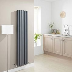 Combining great looks and a stunning heating performance the Milano Black Vertical Designer Radiator x BTU's (Double Panel) makes for an impressive home heating solution. This vertically mounted radiator features a twin array of oval colum Vertical Radiators, Column Radiators, Solid Brick, Brick And Wood, Bathroom Shop, Big Bathrooms, Black Radiators, Kitchen Radiators, Roof Insulation